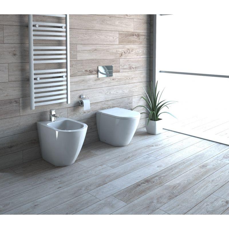 Wc e bidet a terra in ceramica con copriwater chiusura for Sanitari di piccole dimensioni