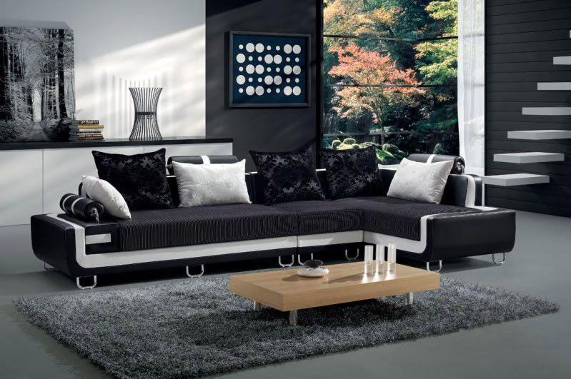 Divano nero con cuscini design casa creativa e mobili - Divano bianco e grigio ...